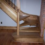 Custom designed Artisan staircase reproduction with carvings and winder