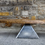 6' long Cocktail Table.  Custom-sawn log with welded pyramid steel support