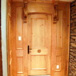 Custom Designed and crafted interior wood paneling, door, brackets