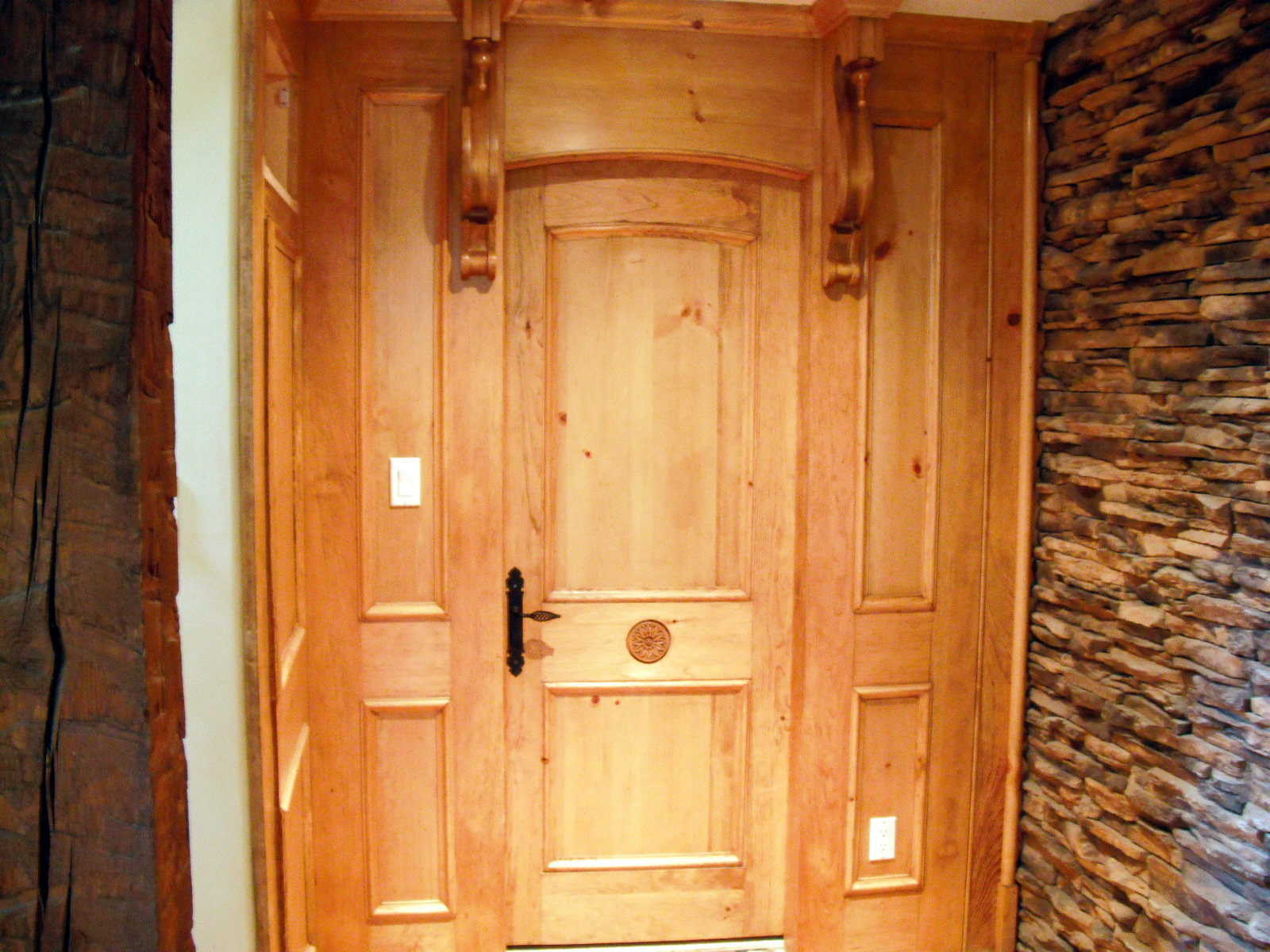 Wonderful image of Custom Designed and crafted interior wood paneling door brackets with #B67215 color and 1600x1200 pixels