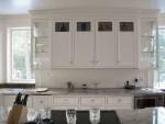 Integral glass doors help  to lighten the room