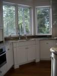 Rosette panel at kitchen sink cabinet
