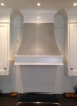 Custom steel range hood in our painted bespoke kitchen