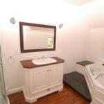 Mahogany top, white-painted hardwood vanity, wood panelling