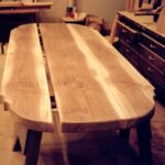 """Book-matched, 4"""" planks of solid walnut.  Pegged together with a dovetail key under.  This massive table in the Baroque style would have been a natural in a rural European Estates"""