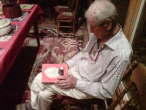 Stanley Burke, autographing my childhood copies of his books.